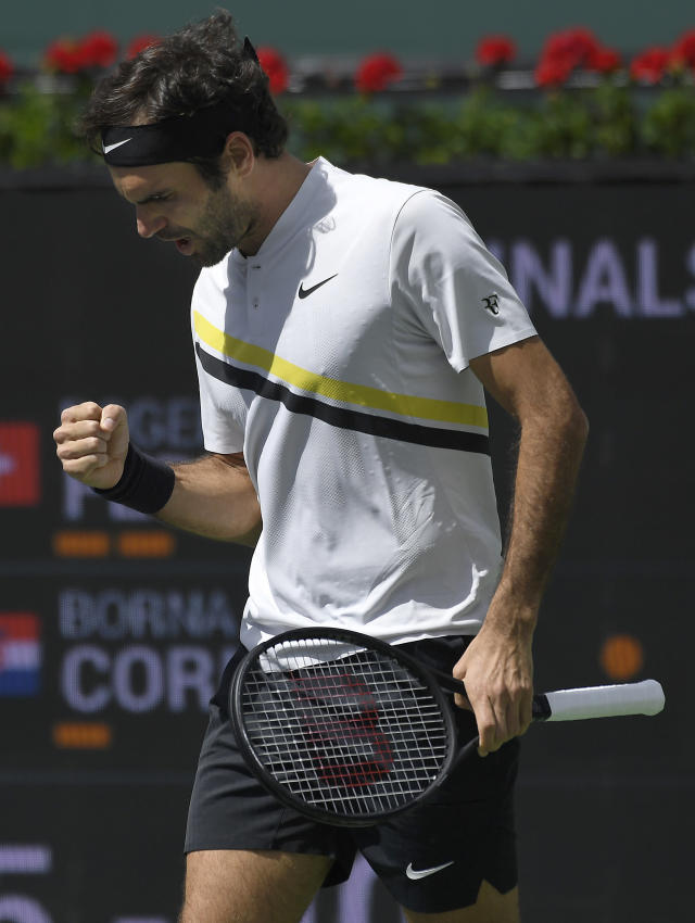 Roger Federer, of Switzerland, celebrates after winning a set against Borna Coric, of Croatia, during the semifinals at the BNP Paribas Open tennis tournament, Saturday, March 17, 2018, in Indian Wells, Calif. (AP Photo/Mark J. Terrill)