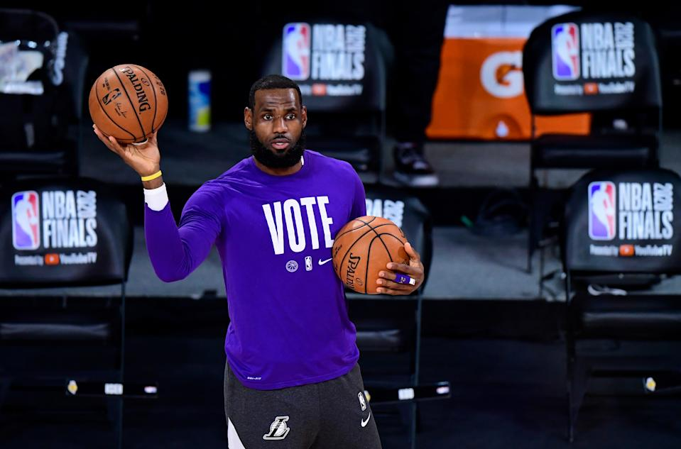 LAKE BUENA VISTA, FLORIDA - OCTOBER 11: LeBron James #23 of the Los Angeles Lakers warms up prior to the start of the game against the Miami Heat in Game Six of the 2020 NBA Finals at AdventHealth Arena at the ESPN Wide World Of Sports Complex on October 11, 2020 in Lake Buena Vista, Florida. NOTE TO USER: User expressly acknowledges and agrees that, by downloading and or using this photograph, User is consenting to the terms and conditions of the Getty Images License Agreement. (Photo by Douglas P. DeFelice/Getty Images)