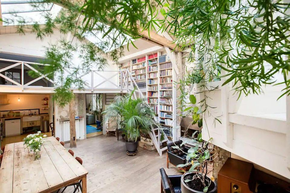 """<p>This leafy Airbnb in Canal Saint-Martin is an ancient industrial building converted into a charming loft, that's perfect for a group of family or friends. Located on the canal in one of the most lively and trendy areas of Paris, it's only a 15-minute walk from the Marais area, too. Inside, the loft is a haven, featuring four bedrooms and beautiful spaces to dine and socialise - all with a very French vibe.</p><p><strong>Sleeps:</strong> 11</p><p><strong>Price per night:</strong> £479</p><p><a class=""""link rapid-noclick-resp"""" href=""""https://airbnb.pvxt.net/DVbX42"""" rel=""""nofollow noopener"""" target=""""_blank"""" data-ylk=""""slk:SEE INSIDE"""">SEE INSIDE</a></p>"""
