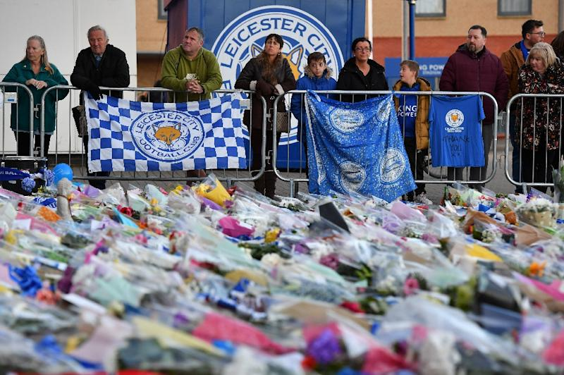Fans fearing the worst had laid out flowers, football scarves and Buddhist prayers outside Leicester City's King Power stadium after the accident (AFP Photo/Ben STANSALL)