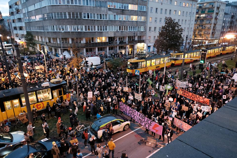 Demonstrators block a street during a protest against the ruling by Poland's Constitutional Tribunal that imposes a near-total ban on abortion, in Warsaw, Poland October 26, 2020. Slawomir Kaminski/Agencja Gazeta via REUTERS ATTENTION EDITORS - THIS IMAGE WAS PROVIDED BY A THIRD PARTY. POLAND OUT. NO COMMERCIAL OR EDITORIAL SALES IN POLAND.
