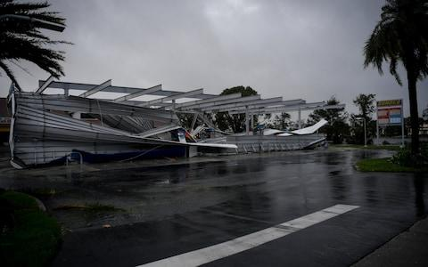 The crumbled canopy of a gas station damaged by Hurricane Irma is seen in Bonita Springs in Florida - Credit: Reuters