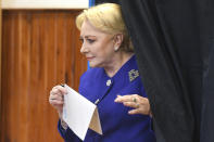 Former Prime Minister and presidential candidate for the Social Democratic party Viorica Dancila exits a voting cabin in Bucharest, Romania, Sunday, Nov. 10, 2019. Voting got underway in Romania's presidential election after a lackluster campaign overshadowed by a political crisis which saw a minority government installed just a few days ago. (AP Photo/Andreea Alexandru)