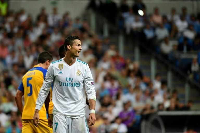 Real Madrid forward Cristiano Ronaldo looks on during the UEFA Champions League football match Real Madrid CF vs APOEL FC at the Santiago Bernabeu stadium in Madrid