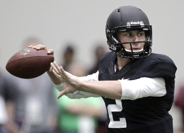 Texas A&M quarterback Johnny Manziel passes the ball during a drill at pro day for NFL football representativesin College Station, Texas, Thursday, March 27, 2014. (AP Photo/Patric Schneider)