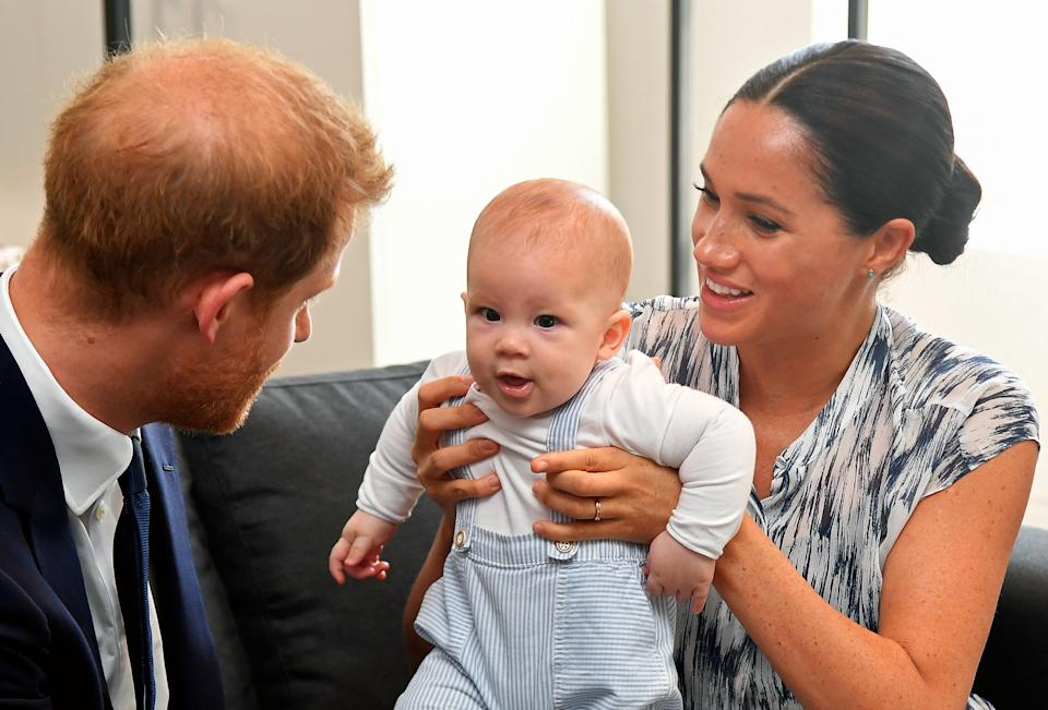 CAPE TOWN, SOUTH AFRICA - SEPTEMBER 25: Prince Harry, Duke of Sussex and Meghan, Duchess of Sussex tend to their baby son Archie Mountbatten-Windsor at a meeting with Archbishop Desmond Tutu at the Desmond & Leah Tutu Legacy Foundation during their royal tour of South Africa on September 25, 2019 in Cape Town, South Africa. (Photo by Toby Melville - Pool/Getty Images)