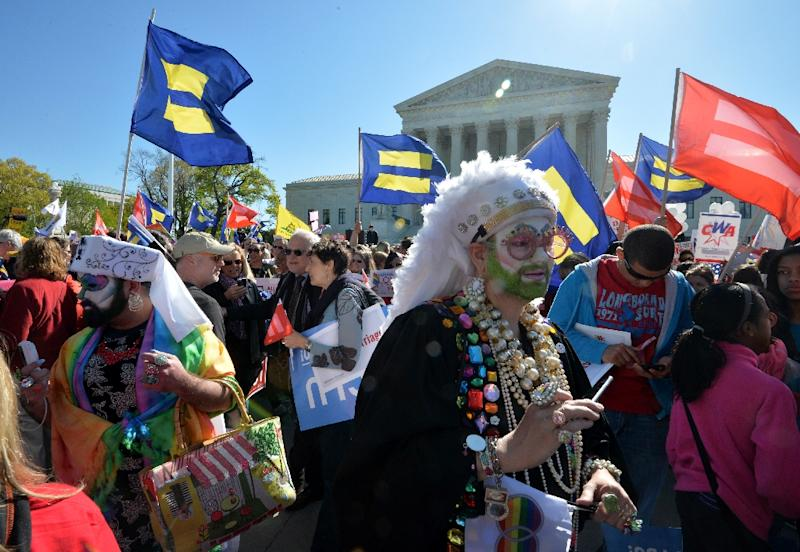 Supporters of same-sex marriage gather outside the US Supreme Court on April 28, 2014 in Washington, DC (AFP Photo/Mladen Antonov)