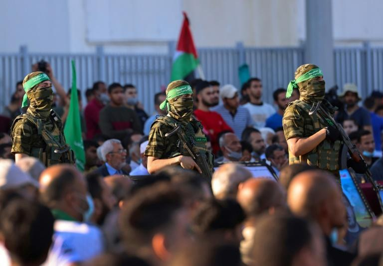 Members of Al-Qassam Brigades, the armed wing of the Hamas movement, attend a rally in Gaza City on May 24