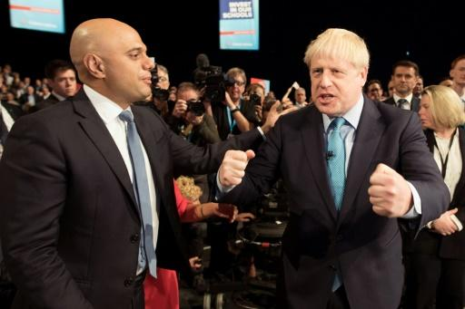 Javid's (L) resignation is a major upset at a turbulent time for Britain