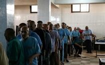 """Patients queue for food rations at a mental health clinic on July 6, 2017. Facility staff say they are """"psychologically exhausted"""""""