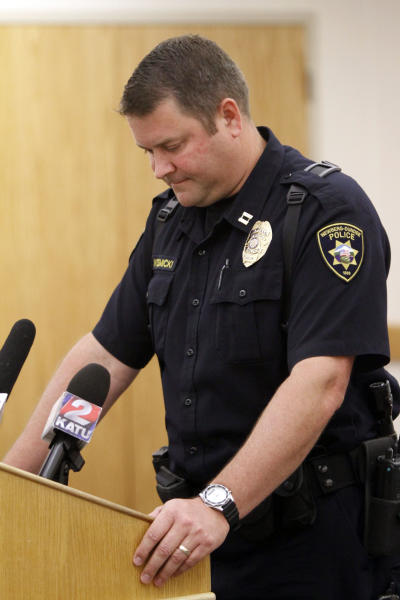 Newberg, Ore. Police Capt. Jeff Kosmicki pauses during a press conference Thursday, July 5, 2012, in Newberg, Ore., regarding the discovery of a deceased family of four found in their home Wednesday in nearby Dundee, Ore. Kosmicki said the preliminary investigation leads them to believe that the deaths are a murder-suicide. A statement Thursday from the Newberg-Dundee police named two of the dead, 37-year-old Randall Engels and 35-year-old Amy Engels. It said their children, who were not named, were also victims. (AP Photo/Don Ryan) (AP Photo/Don Ryan)