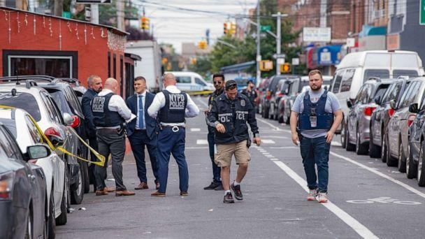PHOTO:New York Police Department officers investigate following a shooting in Queens, N.Y, Aug. 1, 2021.  (Ron Adar/SOPA Images via ZUMA Press)