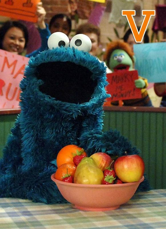"V is for Veggie Monster: Cookie Monster's sweet tooth finally caught up with him in 2006 when <a href=""/sesame-street/show/33526"">""Sesame Street""</a> launched a Healthy Habits for Life campaign. Fans thought for sure he was going to get the ax -- or worse, change his name to Veggie Monster -- so they started a movement of their own. When the dust settled, the blue eating-machine announced ""Cookies are a sometimes food."" Since then he's been known to eat everything from fruit to microphones to <a href=""/stephen-colbert/contributor/46293"">Stephen Colbert's</a> Peabody Award. <a href=""http://www.zap2it.com/"" rel=""nofollow"">Source: Zap2it</a>"