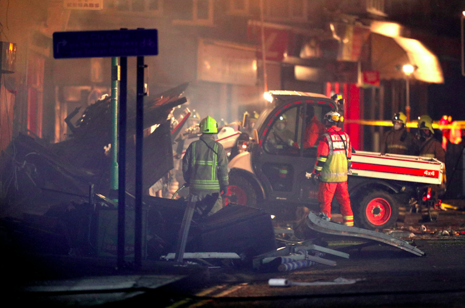 <em>Fire crews worked through the night to search the rubble (PA)</em>
