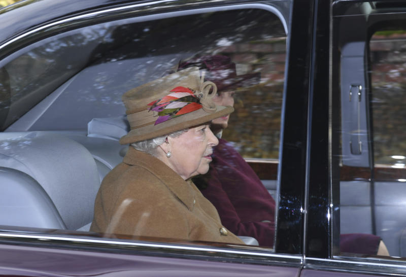 "Britain's Queen Elizabeth II arrives to attend a morning church service at St Mary Magdalene Church in Sandringham, England, Sunday Jan. 12, 2020. Prince Harry and his wife Meghan have declared they will ""work to become financially independent"" as part of a surprise announcement saying they wish ""to step back"" as senior members of the royal family. (Joe Giddens/PA via AP)"