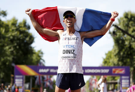 Athletics - World Athletics Championships – men's 50 km walk – London Stadium, London, Britain – August 13, 2017 – Yohann Diniz of France celebrates winning the gold medal. REUTERS/Matthew Childs