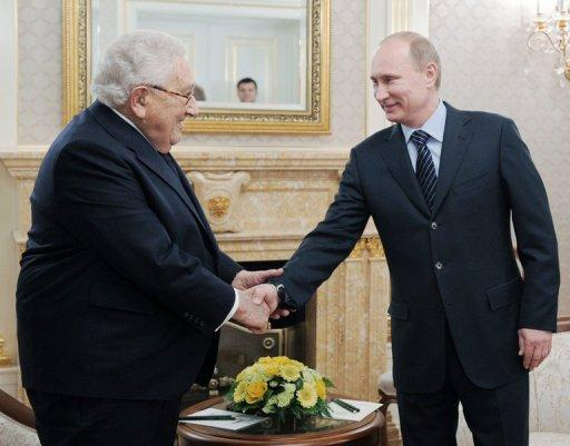 Prime Minister Vladimir Putin, pictured with former US secretary of state Henry Kissinger, cautioned Monday against attempts to stir up ethnic discord and warned that he was ready to ban nationalist parties as he stepped up his Russian presidential campaign