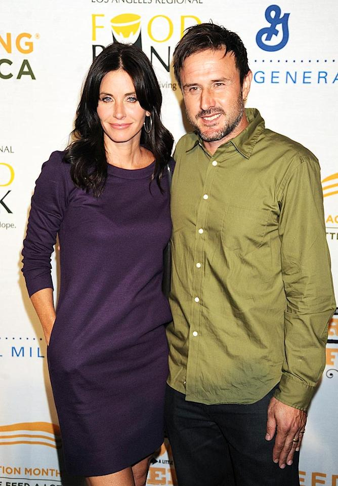 "Courteney Cox Arquette and her hubby David posed for a cute picture upon arriving at the ""Rock a Little, Feed a Lot"" benefit concert at Club Nokia in downtown Los Angeles. Jeff Kravitz/<a href=""http://www.filmmagic.com/"" target=""new"">FilmMagic.com</a> - September 29, 2009"
