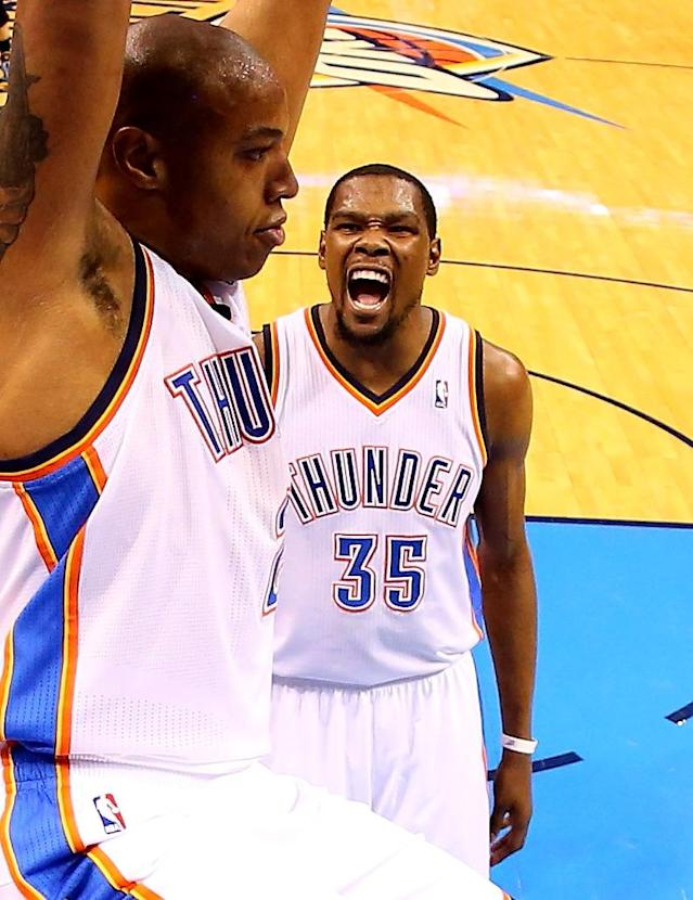 OKLAHOMA CITY, OK - MAY 03: Kevin Durant #35 of the Oklahoma City Thunder celebrates a dunk by Caron Butler #2 against the Memphis Grizzlies in Game Seven of the Western Conference Quarterfinals during the 2014 NBA Playoffs at Chesapeake Energy Arena on May 3, 2014 in Oklahoma City, Oklahoma. (Photo by Ronald Martinez/Getty Images)