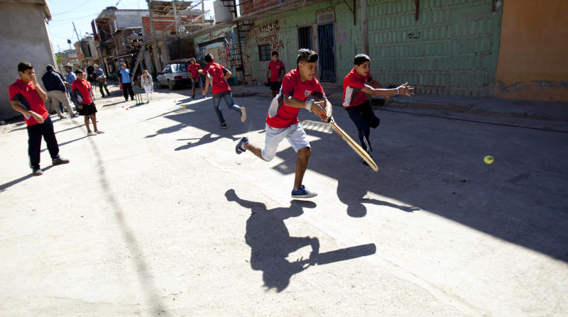 Caacupe cricket team members play during a training session at the Villa 21-24 slum in Buenos Aires, Argentina, Saturday, March 22, 2014. The International Cricket Council has recognized the team, formed from the children of the Villa 21-24 shantytown, honoring them as a global example for expanding the sport, which in certain countries, like India, is widely played, but in many parts of the world restricted to elite sectors of society. Introducing cricket in the slum began in 2009 as an idea to transform the game into a social integration mechanism, before that it rarely breached the gates of the country's upscale private schools. (AP Photo/Natacha Pisarenko)