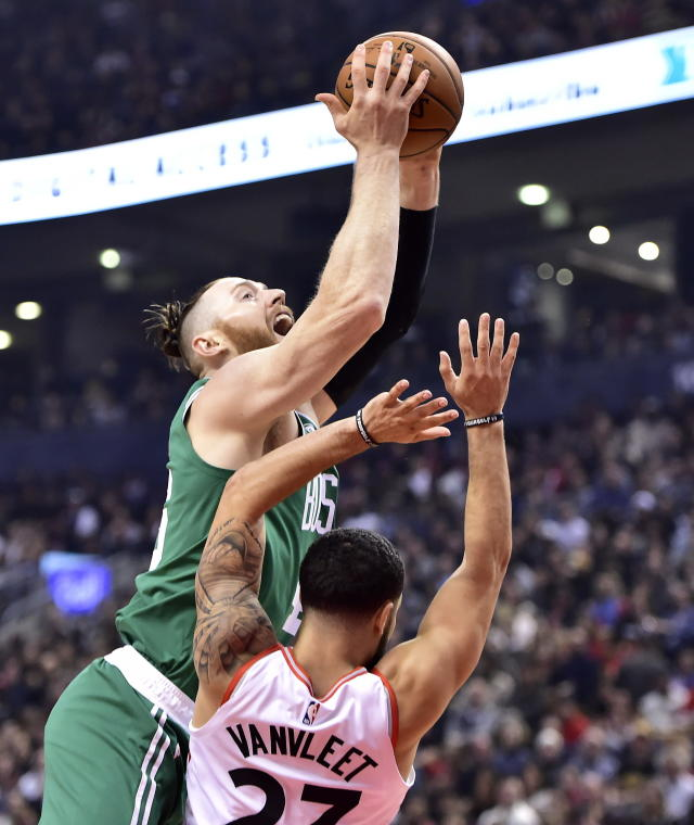 Toronto Raptors guard Fred VanVleet (23) picks up a foul on Boston Celtics forward Aron Baynes (46) as he drives to the basket during the first half of an NBA basketball game, Friday, Oct. 19, 2018 in Toronto. (Frank Gunn/The Canadian Press via AP)
