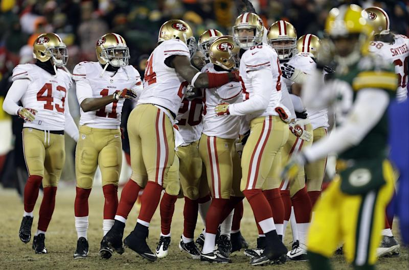 San Francisco 49ers players celebrates after San Francisco 49ers kicker Phil Dawson (9) kicks the game winning field goal during the second half of an NFL wild-card playoff football game, Sunday, Jan. 5, 2014, in Green Bay, Wis. The 49ers won 23-20. (AP Photo/Mike Roemer)
