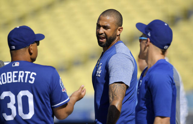 Los Angeles Dodgers manager Dave Roberts, left, talks with Matt Kemp, center, and Enrique Hernandez prior to the team's baseball game against the San Francisco Giants, Friday, June 15, 2018, in Los Angeles. (AP Photo/Mark J. Terrill)