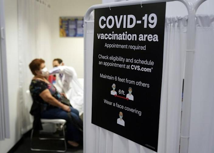FILE - In this March 1, 2021, file photo, a patient receives a shot of the Moderna COVID-19 vaccine at a CVS Pharmacy branch in Los Angeles. California is expanding its vaccine eligibility to anyone 50 and over starting in April and anyone 16 and over on April 15. Gov. Gavin Newsom said, Thursday, March 25, 2021, that California expects to receive 2.5 million doses a week in the first half of April and more than 3 million a week in the second half of the month. (AP Photo/Marcio Jose Sanchez, File)