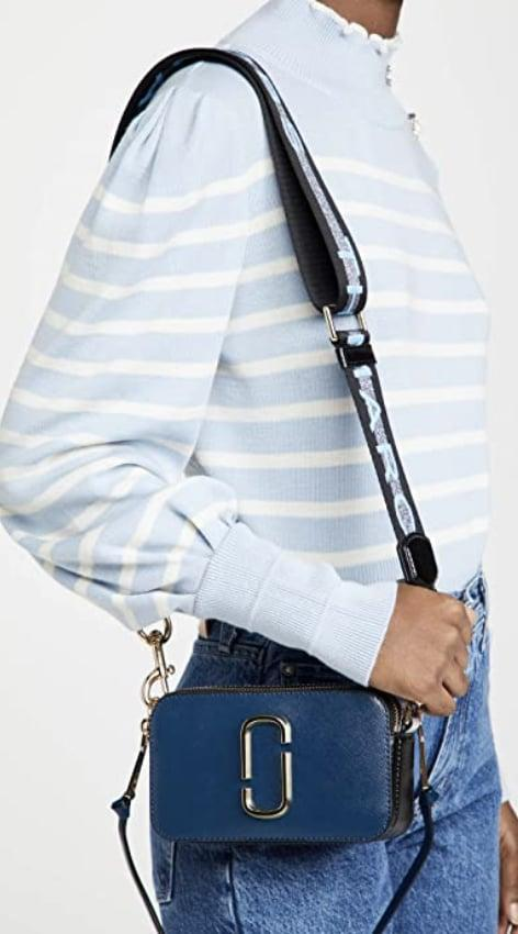 <p>If you're looking to own something designer, this wearable <span>Marc Jacobs Snapshot Camera Bag</span> ($291) is a great place to start. It's fashionable, perfect to carry everything, and you'll cherish it for a long time.</p>