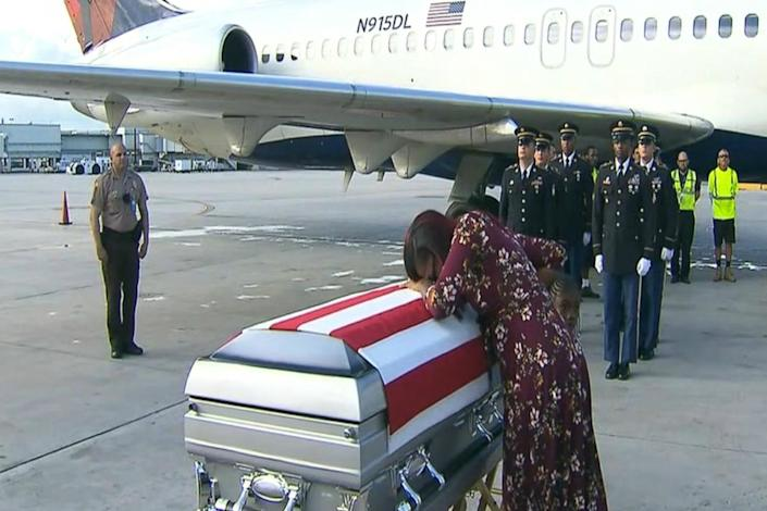 Myeshia Johnson collapses over the flag-draped casket of her husband, Army Sgt. La David Johnson, upon its arrival in Florida on Tuesday. (Screenshot: ABC Miami)
