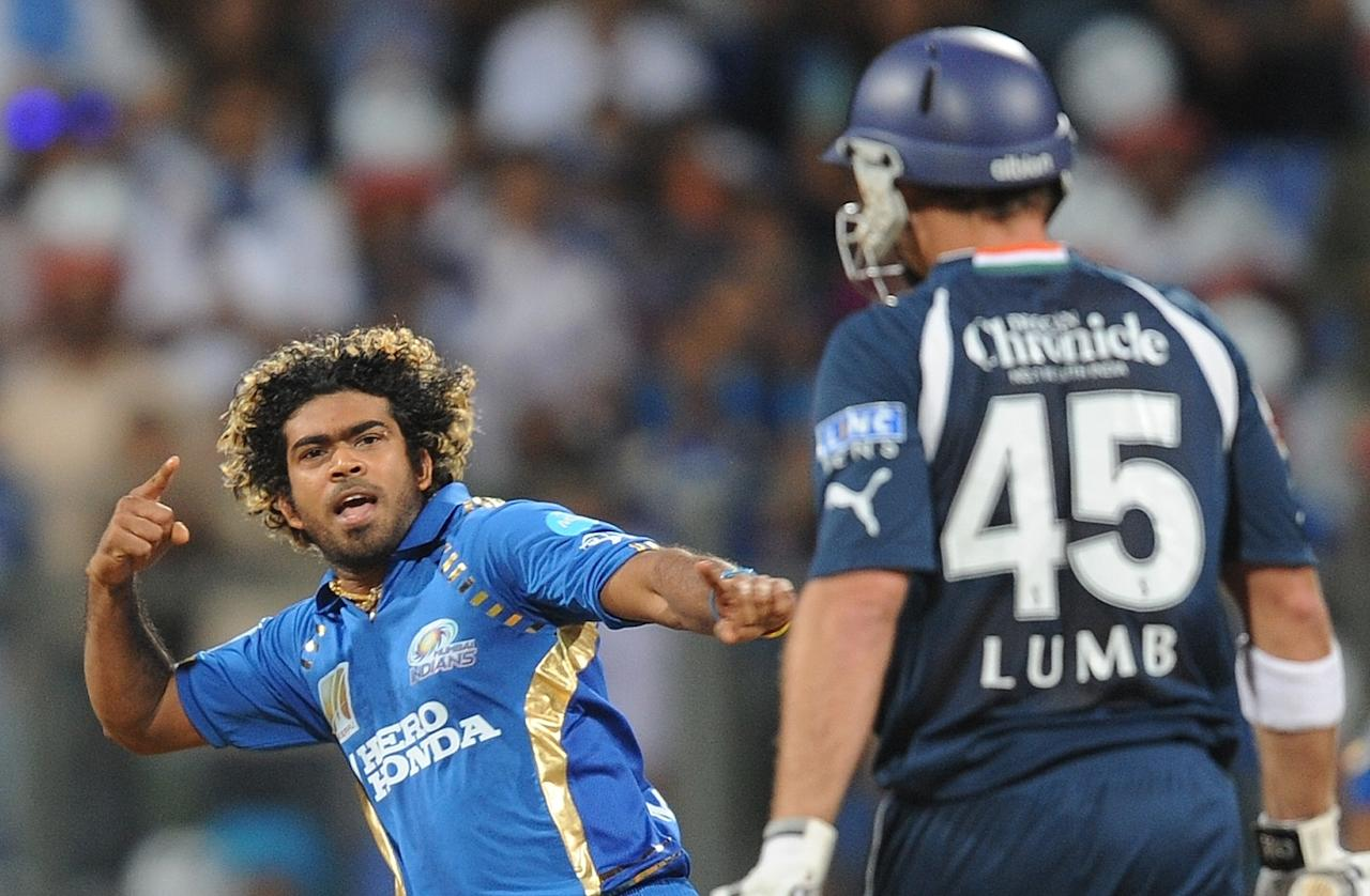 RESTRICTED TO EDITORIAL USE. MOBILE USE WITHIN NEWS PACKAGE Mumbai Indians bowler Lasith Malinga (L) celebrates the wicket of Deccan Chargers batsman Michael Lumb (R) during the IPL Twenty20 cricket match between Mumbai Indians and Deccan Chargers at The Wankhede Cricket stadium in Mumbai on May 14, 2011. AFP PHOTO/Punit PARANJPE (Photo credit should read PUNIT PARANJPE/AFP/Getty Images)