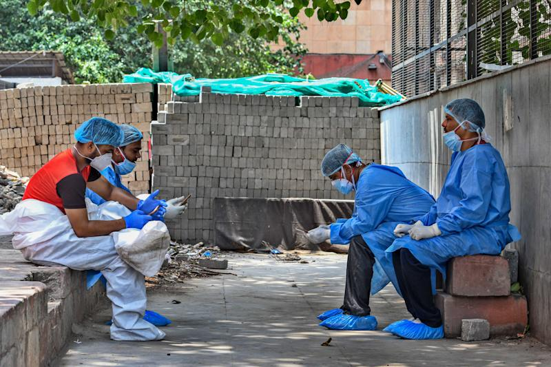 Medical professionals wearing PPE coveralls seen outside the Covid-19 ward at LNJP Hospital, on June 9, 2020 in New Delhi, India. (Photo by Biplov Bhuyan/Hindustan Times via Getty Images)
