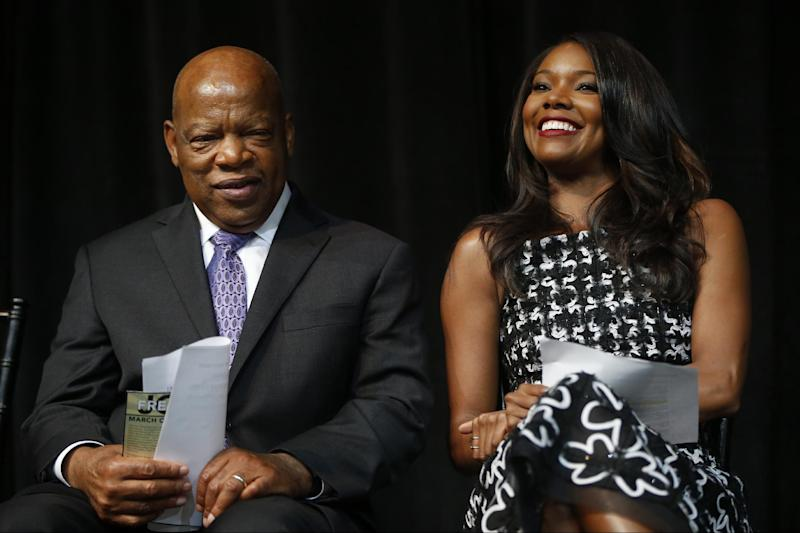 Actress Gabrielle Union and Rep. John Lewis, D-Ga., are seated on stage at the unveiling of a U.S. Postal Service stamp commemorating the 50th anniversary of the March on Washington, Friday, Aug. 23, 2013, at the Newseum in Washington. (AP Photo/Charles Dharapak)