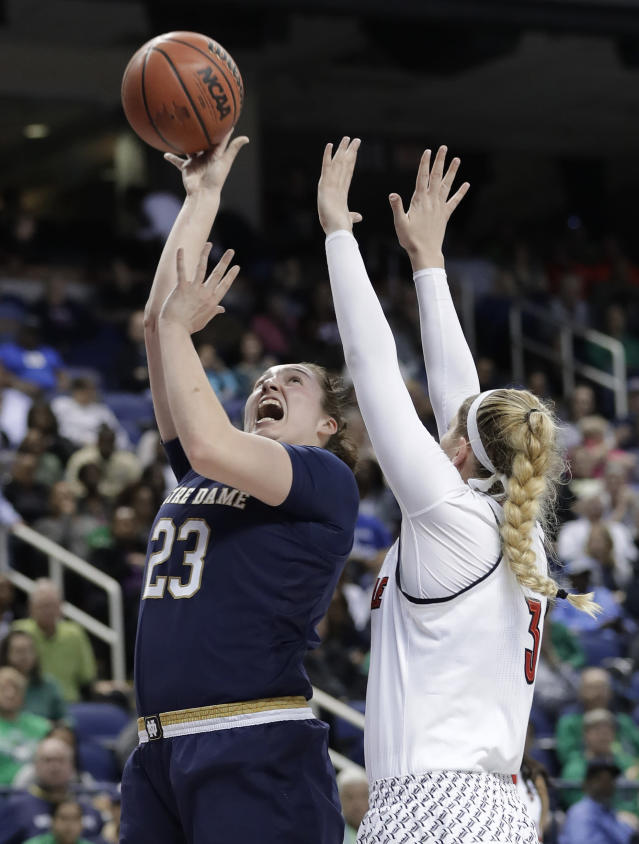 Notre Dame's Jessica Shepard (23) shoots over Louisville's Sam Fuehring (3) during the second half of an NCAA college basketball game in the championship of the women's Atlantic Coast Conference tournament in Greensboro, N.C., Sunday, March 4, 2018. (AP Photo/Chuck Burton)