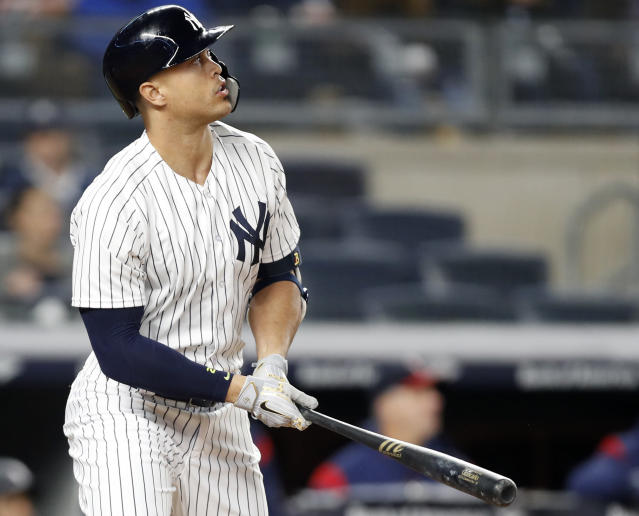 New York Yankees designated hitter Giancarlo Stanton watches his fifth-inning, solo home run in a baseball game against the Minnesota Twins in New York, Monday, April 23, 2018. (AP Photo/Kathy Willens)