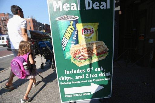 File picture shows an advertisement features 21 ounce drinks in New York City. New York became the first city in the United States to impose a limited ban on super-sized soda drinks blamed by Mayor Michael Bloomberg for fueling a national obesity crisis