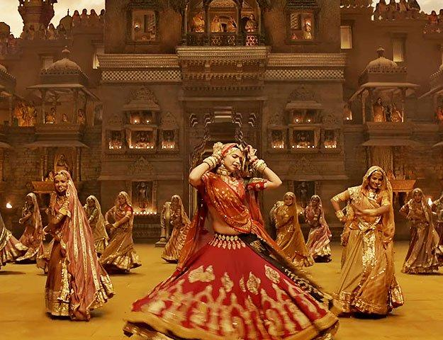<p>The song had become an instant hit, but couldn't evade the heat as members of Rajasthani royalty and the <em>Karni Sena</em> was not excited with the portrayal of their queen her dancing, and mostly the idea of her exposed midriff which has since been covered by applying CGI irked them. While we are thankful the song didn't need to be chopped off completely, we know, covered or exposed, Deepika will not cease stealing hearts. Enough with the teasers and all, this time we will get to watch the complete song, the story it stems from and the one it ensues. </p>