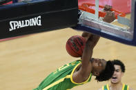 Oregon's Eric Williams Jr. (50) dunks during the first half of a second-round game against Iowa in the NCAA men's college basketball tournament at Bankers Life Fieldhouse, Monday, March 22, 2021, in Indianapolis. (AP Photo/Darron Cummings)