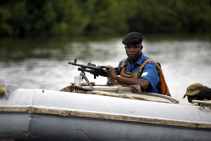 Naval security operatives patrol the creeks of Niger Delta in Buguma on September 30, 2004 (AFP Photo/Pius Utomi Ekpei)