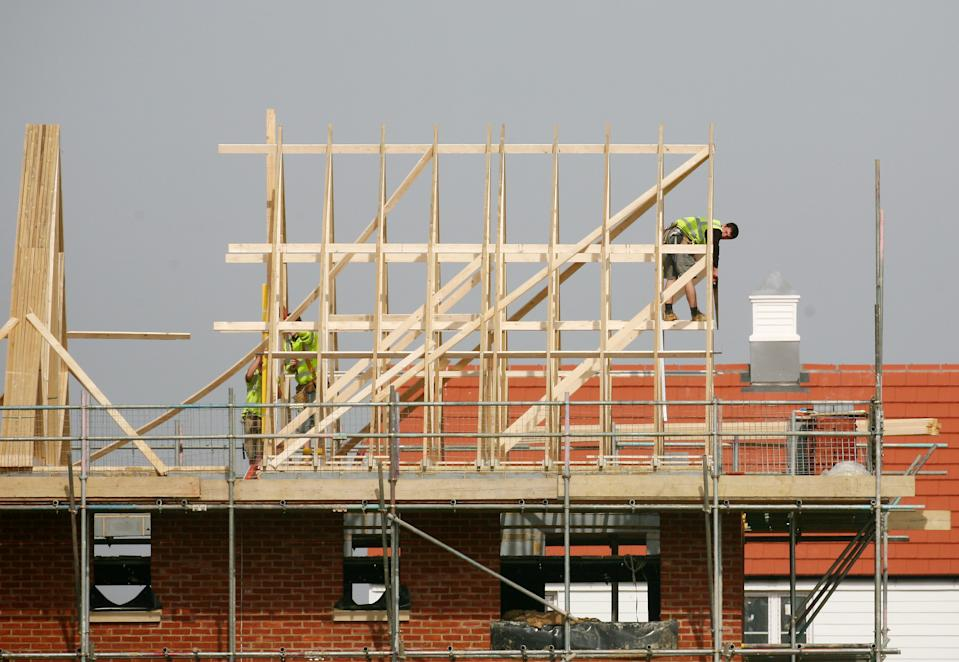 Builders at work on new homes being built around Ashford in Kent.