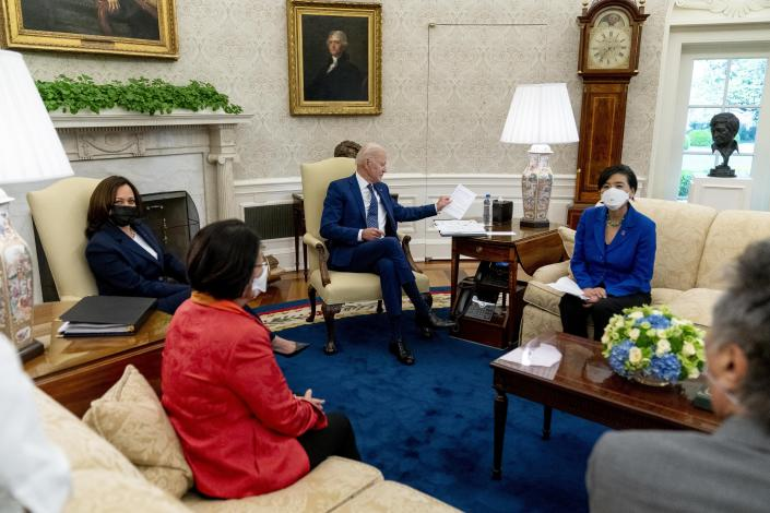 President Joe Biden, center, and Vice President Kamala Harris, meet with Sen. Mazie Hirono, D-Hawaii, second from left, Rep. Judy Chu, D-Calif., Mark Takano, D-Calif., right, and other members of the Congressional Asian Pacific American Caucus Executive Committee in the Oval Office at the White House in Washington, Thursday, April 15, 2021. (AP Photo/Andrew Harnik)