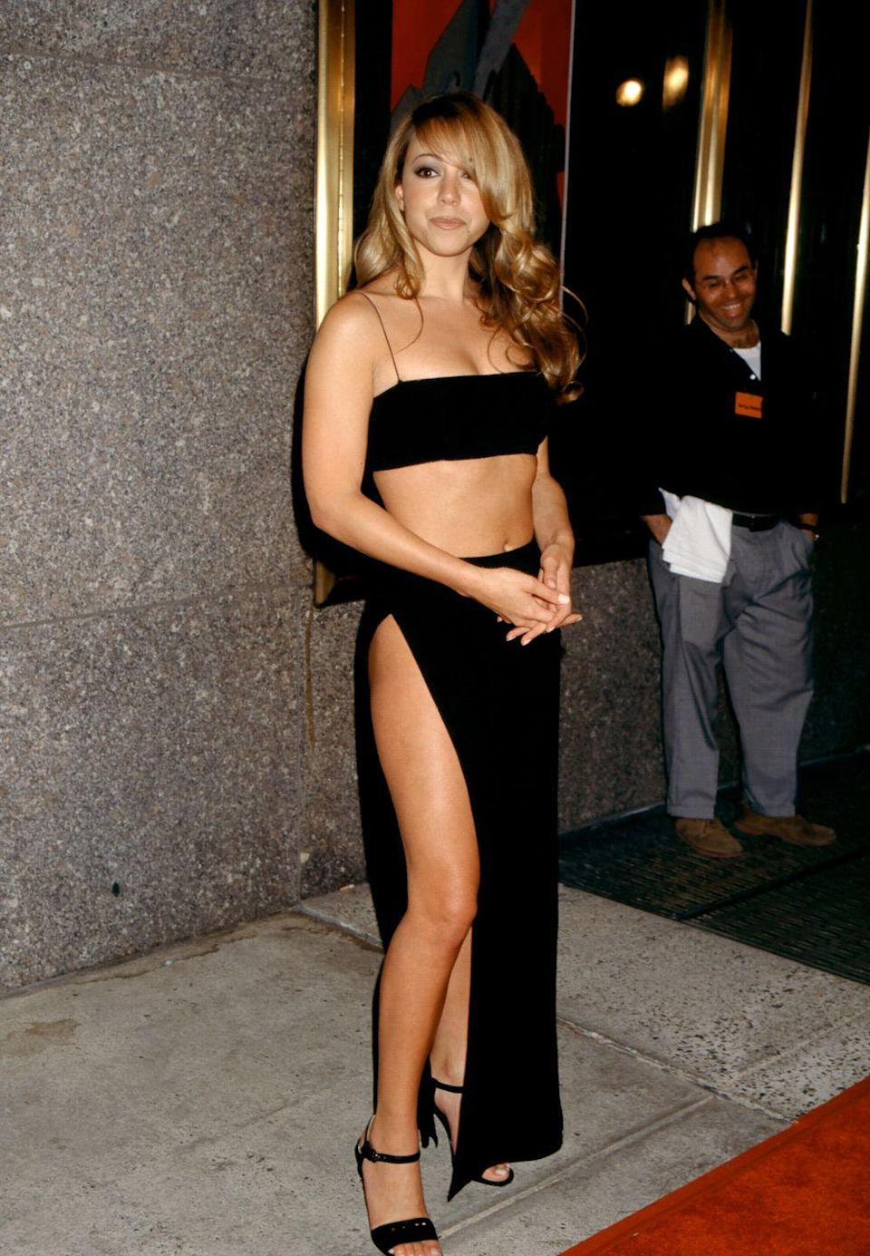 <p>The singer wore a super-slinky two-piece set with a sky-high slit on the skirt to the '97 MTV VMAs. </p>