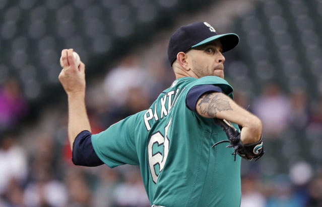 Seattle Mariners starting pitcher James Paxton throws to a Minnesota Twins batter during the first inning of a baseball game Friday, May 25, 2018, in Seattle. (AP Photo/Elaine Thompson)