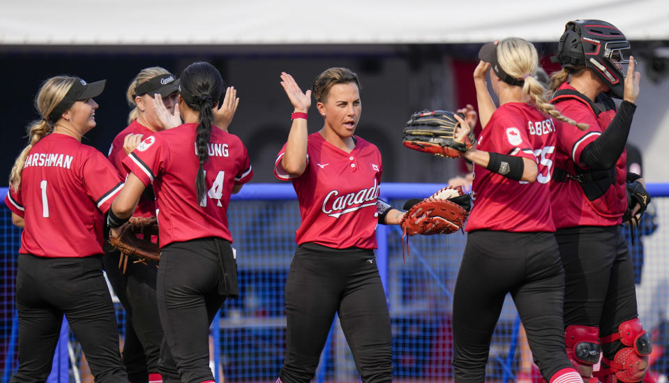 Canadian players celebrate during the softball game between Mexico and Canada at the 2020 Summer Olympics, Wednesday, July 21, 2021, in Fukushima , Japan. (AP Photo/Jae C. Hong)