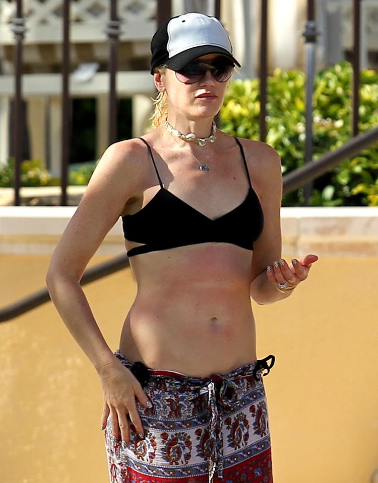 EXCLUSIVE: ***NO WEB*** Gwen Stefani shows off her bikini body at the pool in Miami. The No Doubt singer looked a little sun burnt as she vacationed with husband Gavin Rossdale and sons Kingston and Zuma.