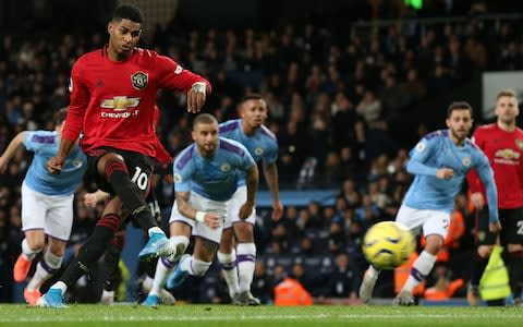 <span>Rashford slots home United's opener from the spot </span> <span>Credit: Getty Images </span>