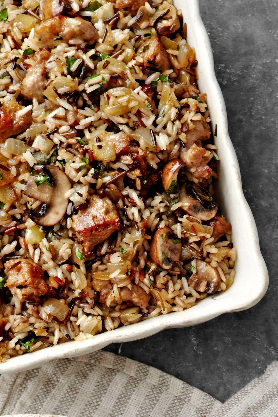 "<p class=""imageContent"">For this take on Thanksgiving dressing, two types of rice are cooked in a fragrant medley of mushrooms and onions sautéed in butter, bay leaf, and fresh sage.</p><p class=""imageContent""><strong><a href=""https://www.countryliving.com/food-drinks/recipes/a4234/wild-rice-basmati-dressing-sausage-sage-recipe-clv1112/"" rel=""nofollow noopener"" target=""_blank"" data-ylk=""slk:Get the recipe"" class=""link rapid-noclick-resp"">Get the recipe</a>.</strong></p>"