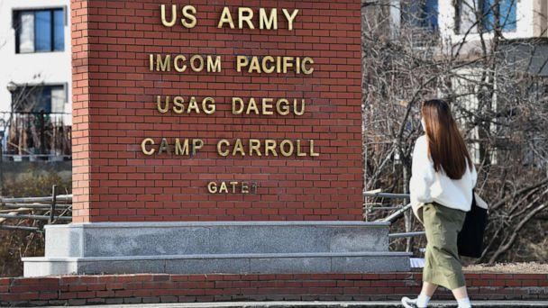 PHOTO: A woman walks past the main gate of U.S. Army Camp Carroll in Chilgok, about 18 miles north of Daegu, South Korea, on Feb. 26, 2020. (Jung Yeon-je/AFP via Getty Images)