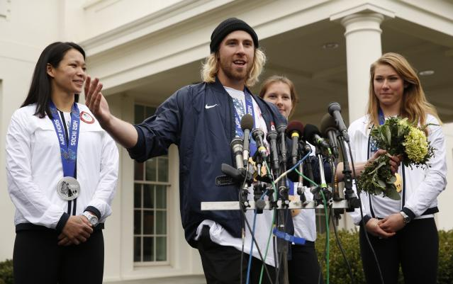 Olympic gold medalist Sage Kotsenberg speaks to reporters at the White House in Washington April 3, 2014. Also pictured are Julie Chu (L), Stephanie Jallen and Mikaela Shiffrin (R). U.S. President Barack Obama and first lady Michelle Obama will honor members of the U.S. teams and delegations from the Sochi Olympics and Paralympics at the White House today. REUTERS/Kevin Lamarque (UNITED STATES - Tags: POLITICS SPORT OLYMPICS)