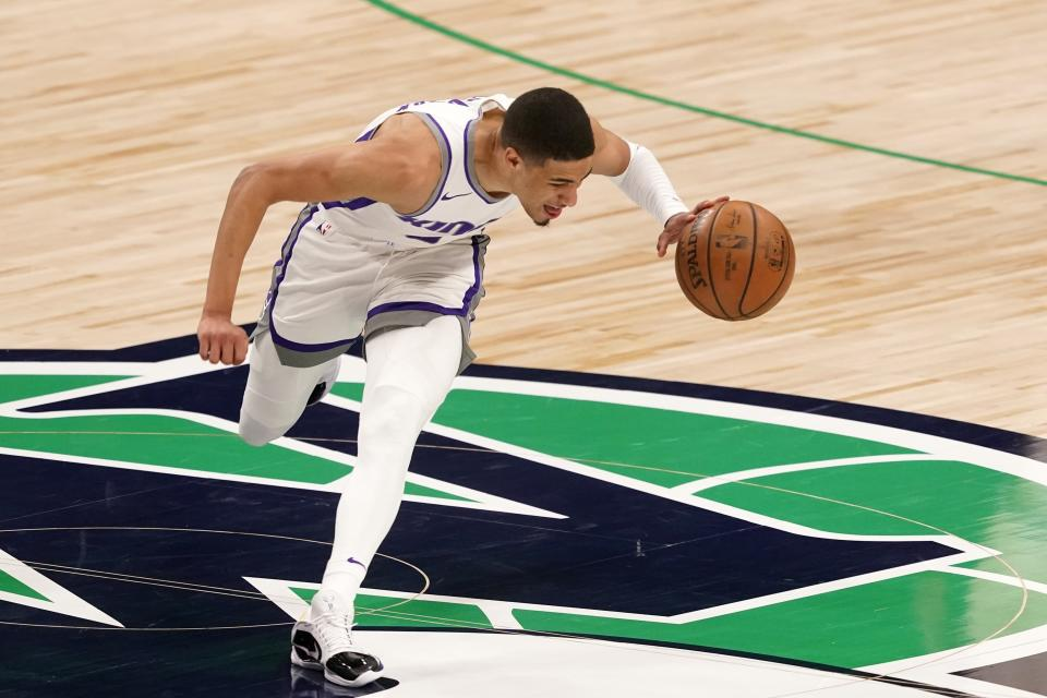 Sacramento Kings' Tyrese Haliburton suffers an unknown leg injury during an NBA basketball game against the Dallas Mavericks in Dallas, Sunday, May 2, 2021. (AP Photo/Tony Gutierrez)